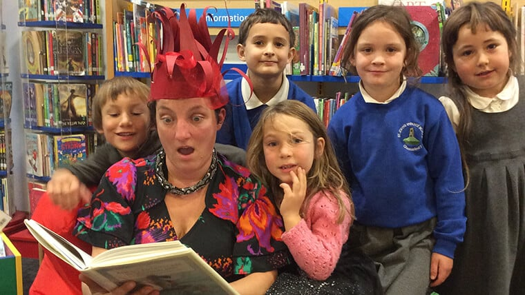 Performing the first chapter of Alice's Adventures in Wonderland at Glastonbury Library